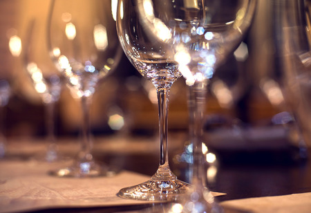 glass  reflection: Close up picture of empty glasses in restaurant. Selective focus. Stock Photo
