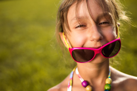 fashionable sunglasses: The image of a little girl in fashionable sunglasses.