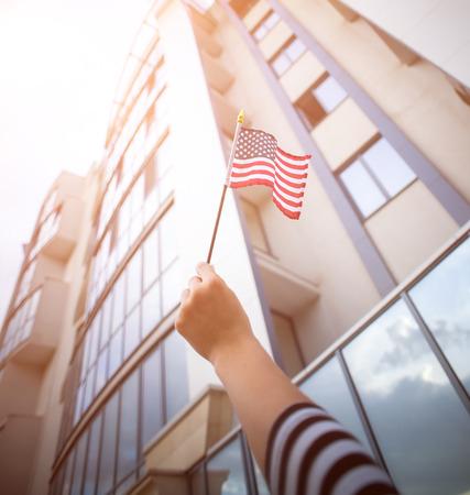 patriotism: woman hand holding american flag.