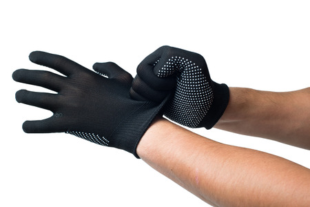 Constructor hands putting on black work gloves. isolated.
