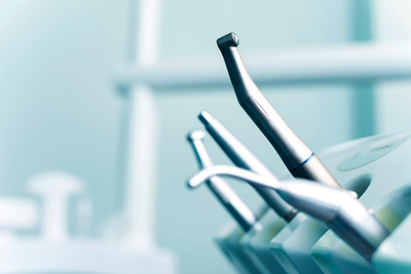 dentist drill: Different dental instruments and tools in a dentists office.