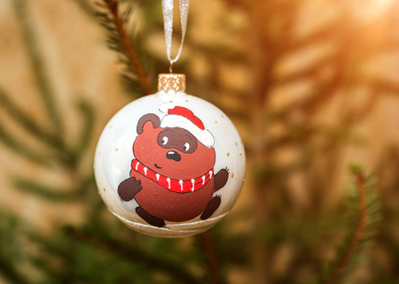 decorating christmas tree: Decorating Christmas tree on bright background.