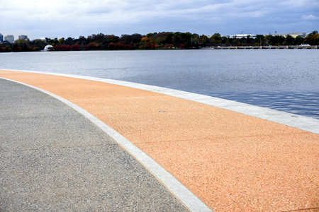 blue waters: Embankment of natural stone and blue waters. Stock Photo