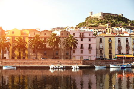 The town of Bosa and the old castle built by the Marquis of Malaspina in 1112 at sunset, Oristano, Sardinia, Italy