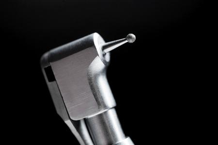 dental fear: Dentist drill on black background.
