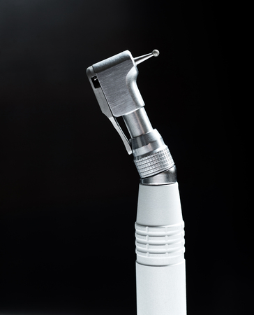dentist drill: Dentist drill on black background.