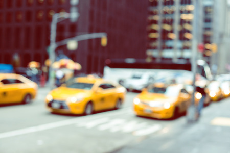 new car lots: Blurred picture of yellow taxies on Manhattan streets. Stock Photo