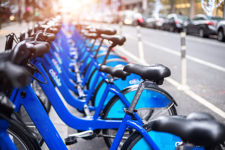 Rent of blue bikes in New York Stock Photo