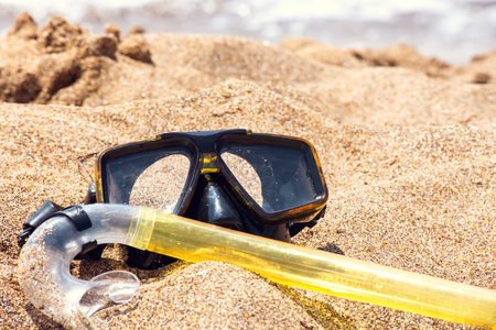 subsea: Vacation Start Here Concept, Scuba Diving Equipment On The White Sea Sand Beach.