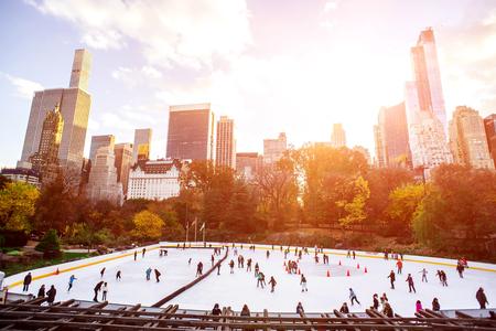 Ice skaters having fun in New York Central Park in fall.