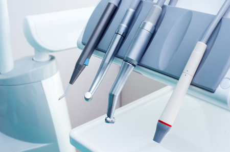odontology: Different dental instruments and tools in a dentists office.