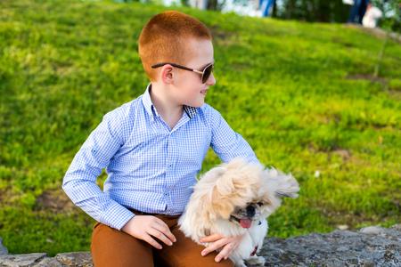 lovingly: Baby boy lovingly embraces his pet dog. Stock Photo