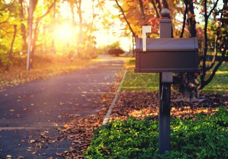 Mail Box in the autumn village. Sunset. Stock Photo