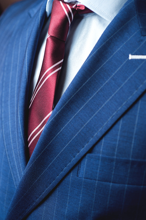 bacground: Close up of classic business attire with tie and elegant blazer. Stock Photo