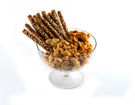Salted nuts and sticks with susan on white