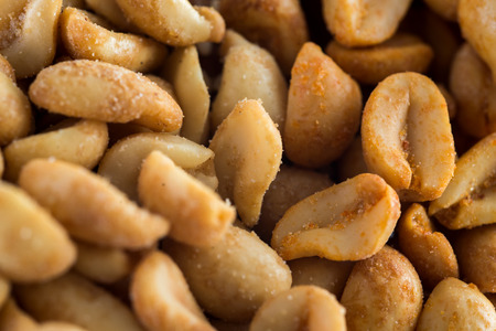 Salted nuts on white background