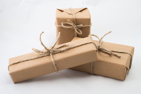 Stack of handcraft gift boxes on white background. Stockfoto
