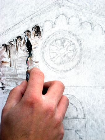 the hand of the painter paint an old church with spatula technique