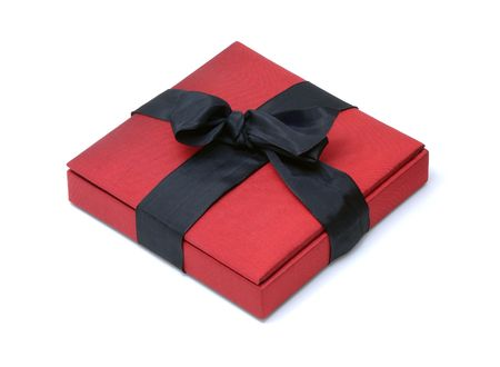 black ribbon bow: Red Silk Box with a Black Ribbon Bow on an Isolated Background