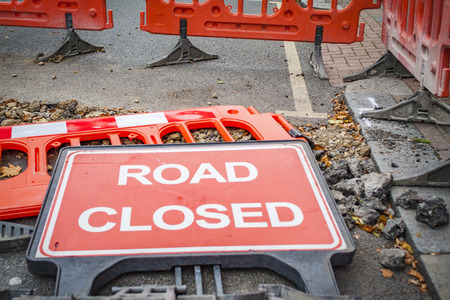 road closed: Road closed sign dropped Stock Photo