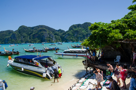 bali province: Chicken Island,Krabi,Thailand-June 6,2016-Many tourists and boats gathered at the seaside.