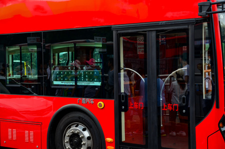 north gate: Palace Gate Beijing North China-July Double-layer 22016 bus tourism and sightseeing 3 at North line Palace Gate station Editorial