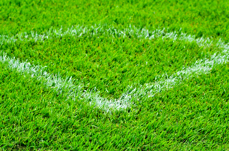 pasto sintetico: Corner lines detail on a soccer field. Foto de archivo