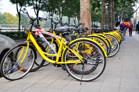 Beijing,China-October 18,2016:Rows of bicycles are placed on the side of the road in Beijing.which named OFO ,a kind of sharing bicycle in China.