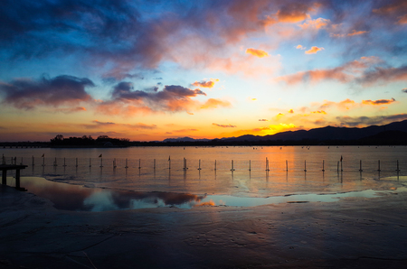 sunset over the lake in winter 写真素材