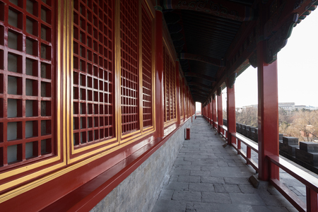 Red windows and corridors of Chinese Qing Dynasty buildings