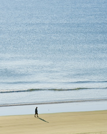 Man having a peaceful morning walk on Daytona Beach