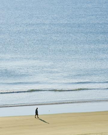 Man having a peaceful morning walk on Daytona Beach Stock Photo - 12819902