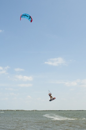 Kite Surfer catching air in Banana River near Cocoa Beach Florida Stock Photo