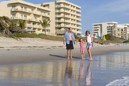 Family walking near the surf on the Beach at Melbourne Florida Stock Photo - 13267099