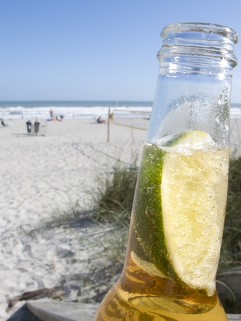 Beer in bottle with Lime on Cocoa Beach Florida photo
