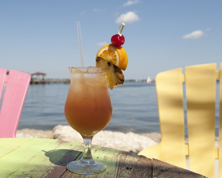 Cocktail in a hurricane glass on a beach by the Indian River Lagoon