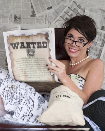 Model portraying woman wanted for Bank Robbery seems amused Stock Photo