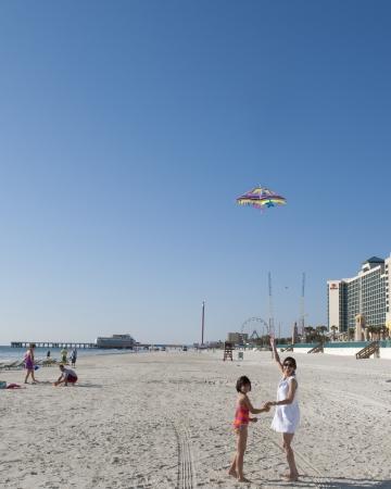 Mother   Daughter Flying Kite at Daytona Beach Florida Stock Photo - 13204183
