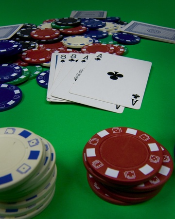 eights: Aces and Eights a dead man s hand with three folded hands at a poker table