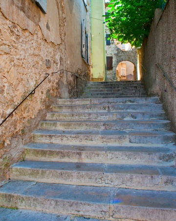 Stair steps from one street level to the next higher in the Medieval Village of Sauve France Stock Photo