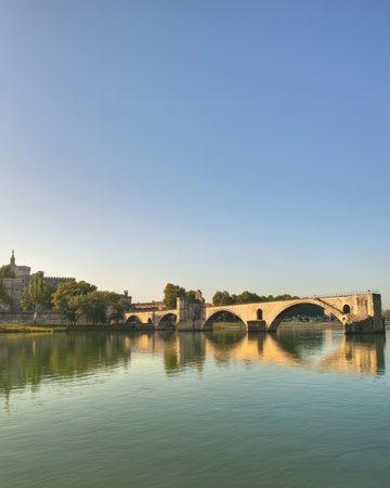 The Popes Bridge from the banks of the Rhone River in Avignon France  Stock Photo