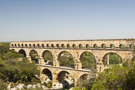 The Roman Aquaduct Pont du Gard in France from atop a nearby hill
