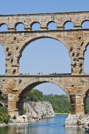 The Roman Aquaduct Pont du Gard in France near Nimes with pedestrians walking accross it
