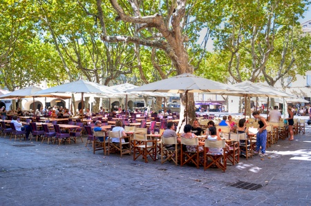 Place with restaurants and guests in the Medieval Village of Uzes Stock Photo - 13413766