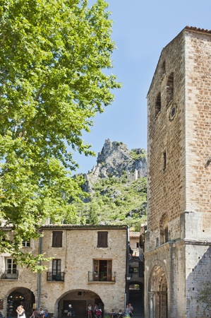 Place in Saint Guilhem France sits under the ancient mountain fortress