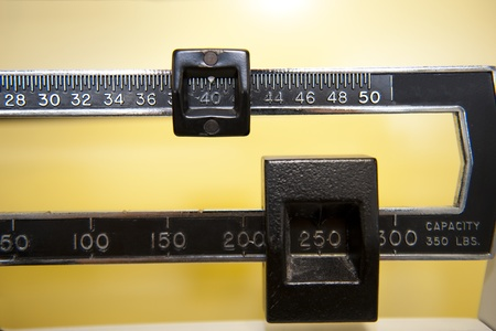 A doctor s scale registering a large amount of weight