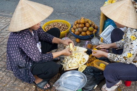 Women Selling Fruit on the streets of Ho Chi Minh City in Saigon Stock Photo