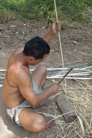 Shaping bamboo using primitive methods  in Muangeko Village
