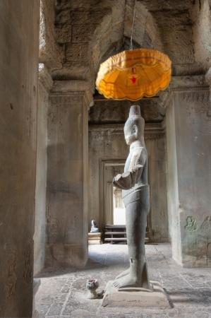 Vishnu Statue at Angkor Wat, Ancient Ruins built in 11th Century Stock Photo