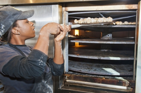 Baking Dough Knots which are an appetizer  at a small business Pizzaria in Florida